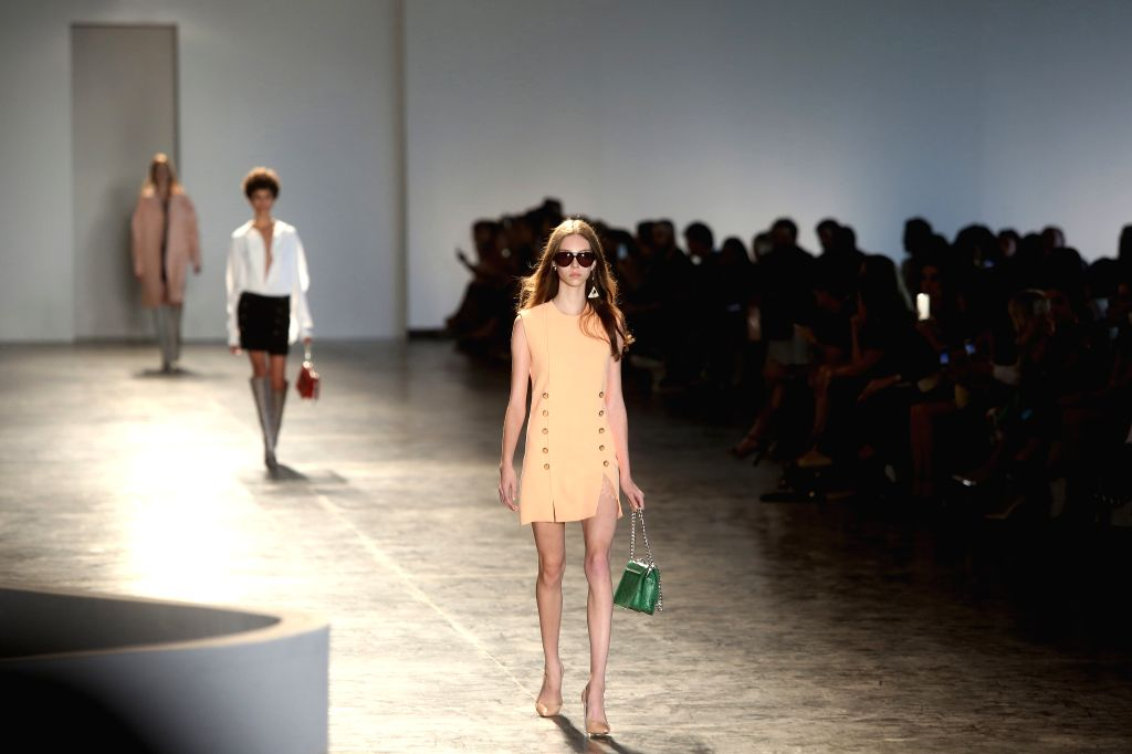 Models present creations of the winter collection by Animale during the Sao Paulo Fashion Week, in Sao Paulo, Brazil, on Oct. 19, 2015. (Xinhua/Rahel ...