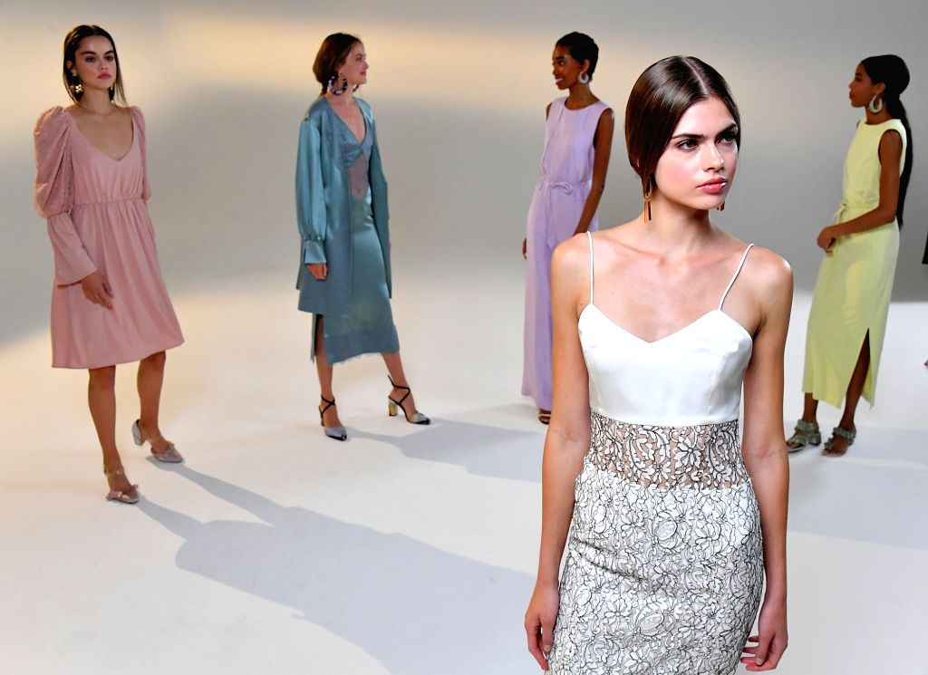 Models present creations of Vivienne Hu Spring/Summer 2021 during the New York Fashion Week (NYFW) in New York, the United States, on Sept. 15, 2020. Most of the ...
