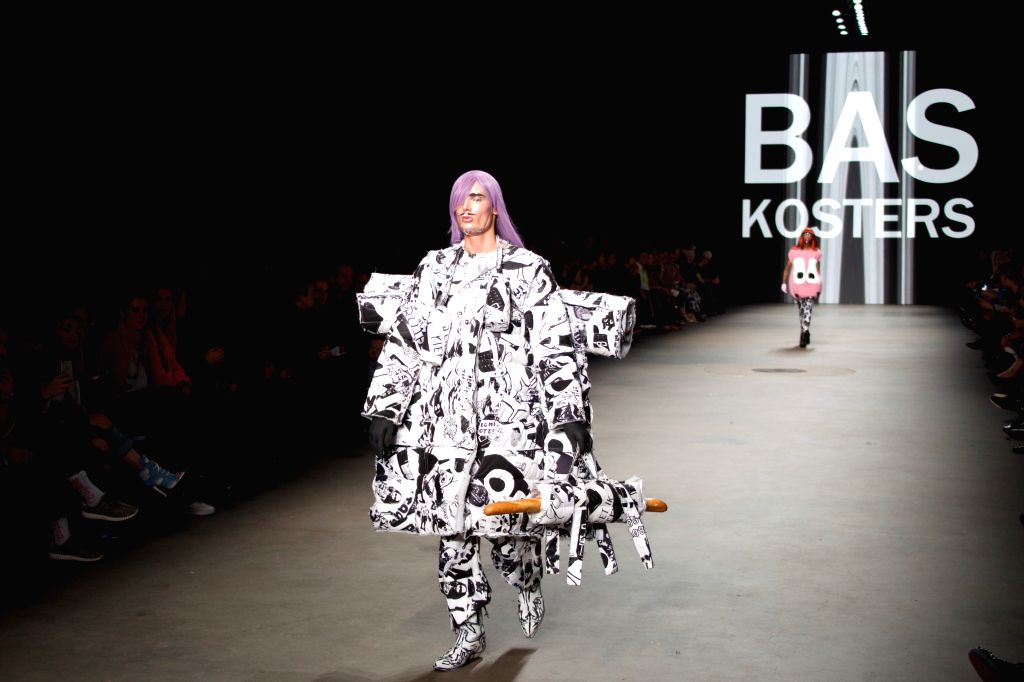 Models present local designers' works during opening show of Amsterdam International Fashion Week in Amsterdam, the Netherlands, Jan. 14, 2016. (Xinhua/Sylvia ...