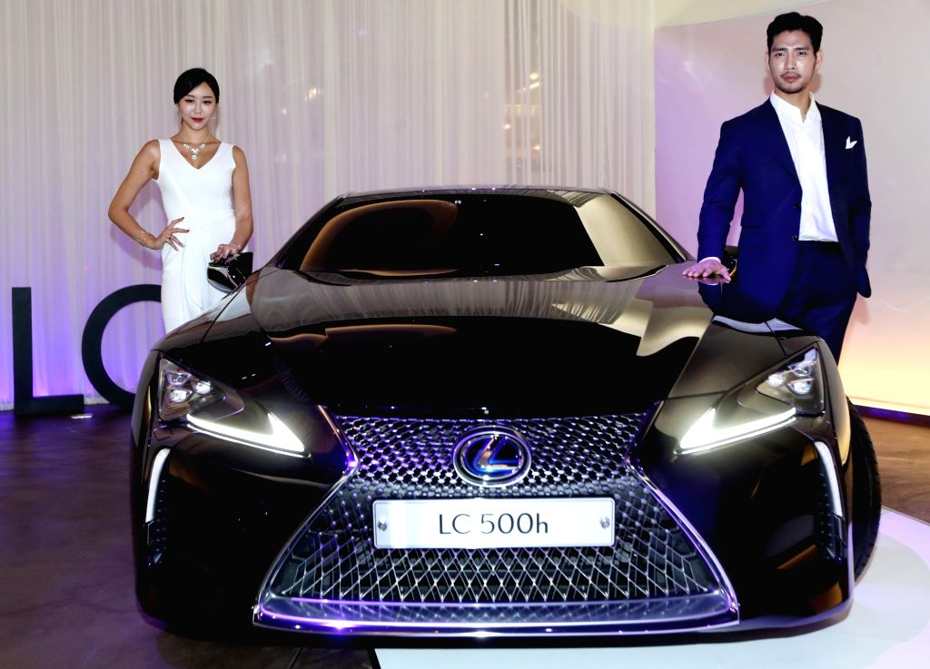 Models show off the new Lexus LC500h coupe in a rollout in eastern Seoul on July 4, 2017. The flagship luxury coupe boasts an all-new platform, a multi-stage hybrid system and a near 10-speed ...