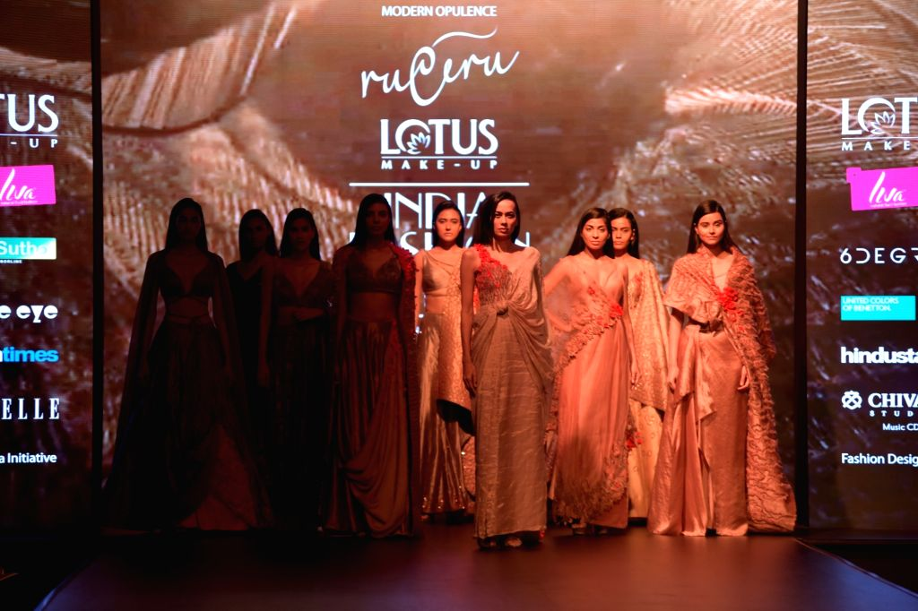 Models showcase a creation of fashion designer Ruceru on the third day of Lotus India Fashion Week in New Delhi, on March 15, 2019.