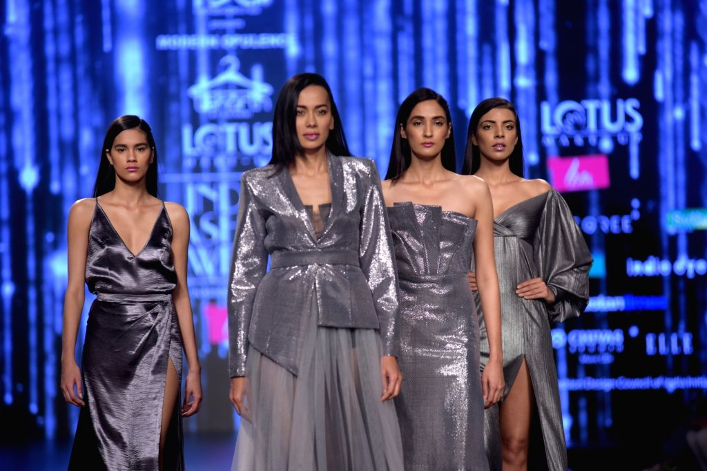 Models showcase a creation of fashion designer Shivani Awasthy on the third day of Lotus India Fashion Week in New Delhi, on March 15, 2019.