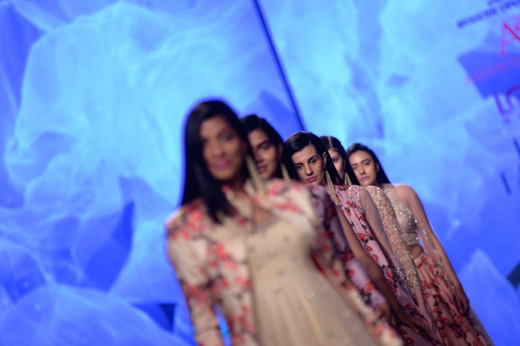 Models showcase a creation of fashion designer Ashwini Reddy on the third day of Lotus India Fashion Week in New Delhi, on March 15, 2019. - Ashwini Reddy