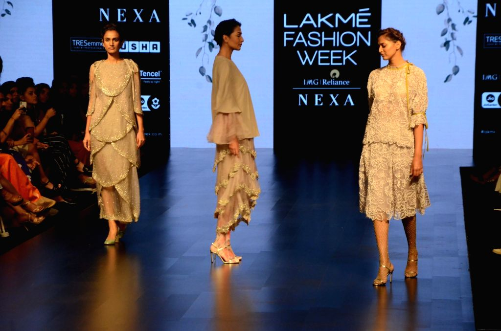Models showcase Aikeyah's creation during the Lakme Fashion Week (LFW) Summer/Resort 2019 in Mumbai on Feb 2, 2019.