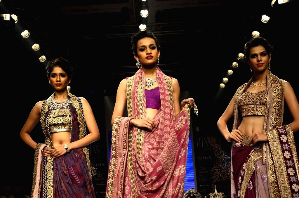 Models showcase creation of fashion designer Shaina NC at the India International Jewellery Week 2015, in Mumbai on Aug 3, 2015.
