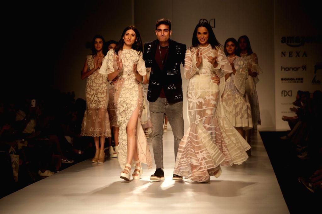 Models showcase creations of fashion designer Sahil Kochhar at Amazon India Fashion Week Summer Spring in New Delhi, on Oct 12, 2017.