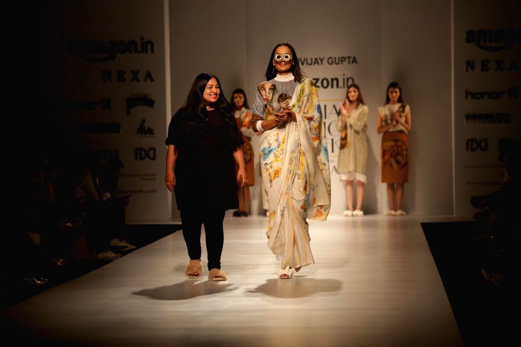 Models showcase creations of fashion designer Aartivijay Gupta at Amazon India Fashion Week Summer Spring in New Delhi, on Oct 12, 2017. - Aartivijay Gupta