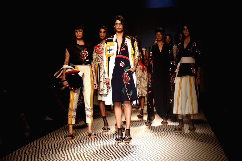 Models showcase creations of fashion designer Vineet Bahl at Amazon India Fashion Week Summer Spring in New Delhi, on Oct 12, 2017.