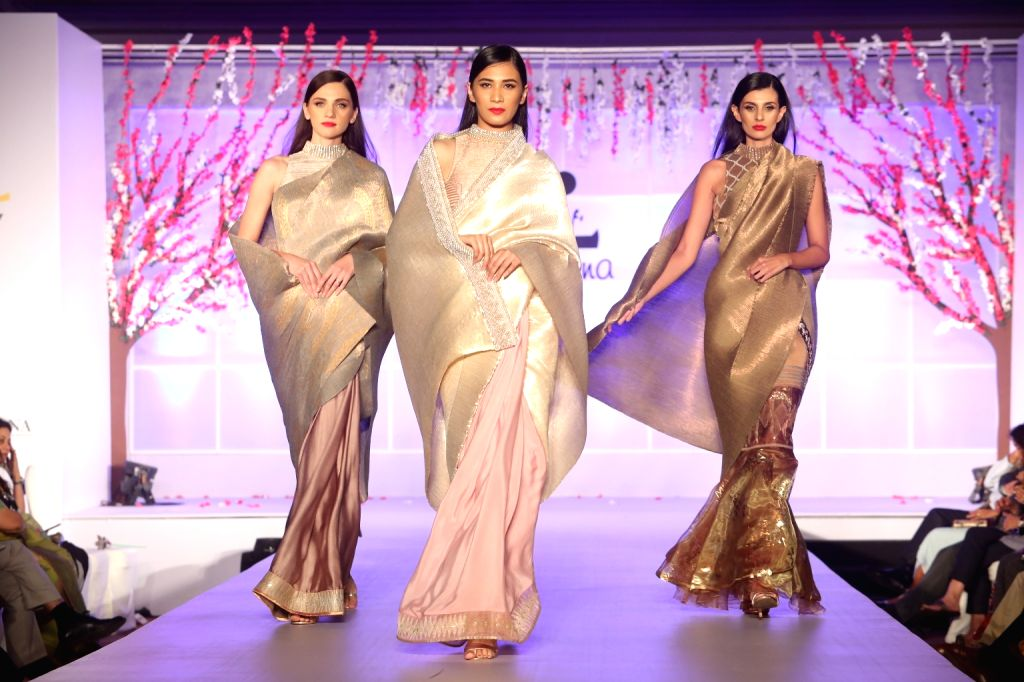 "Models showcase creations of Kiran Uttam Ghosh at ""Unity in Diversity"" - FDCI's annual fashion show in New Delhi on Sept 16, 2018. - Kiran Uttam Ghosh"
