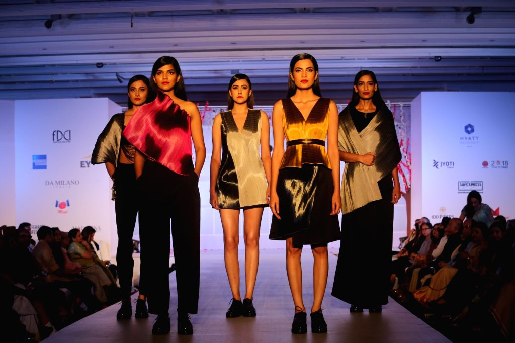 """Models showcase creations of Rimzim Dadu at """"Unity in Diversity"""" - FDCI's annual fashion show in New Delhi on Sept 16, 2018."""