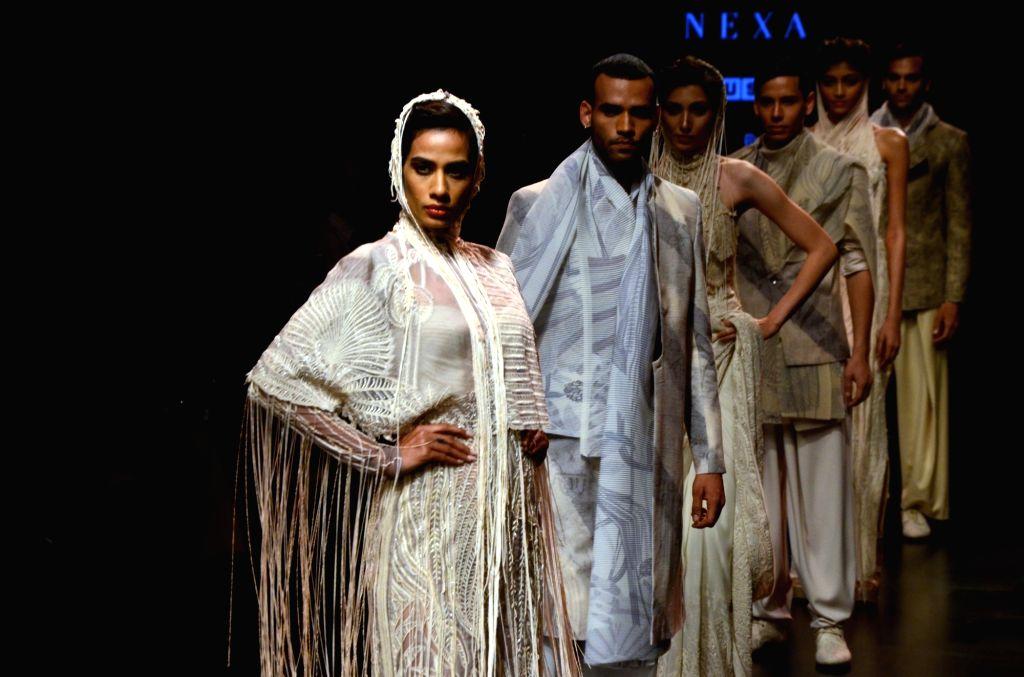 Models showcase fashion designer Abhishek Sharma's creation during the Lakme Fashion Week (LFW) Summer/Resort 2019 in Mumbai on Feb 2, 2019. - Abhishek Sharma