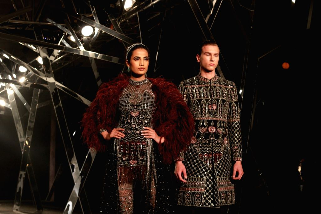 Models showcase fashion designer Falguni Peacock's creations at the India Couture Week 2019 in New Delhi, on July 26, 2019.