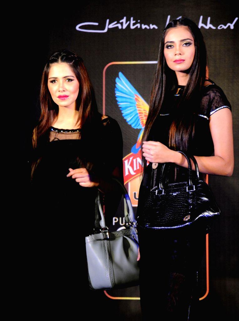 Models showcase fashion designer Jattinn Kochhar and Sheetal Lyall's creation during Kingfisher Ultra Punjab Style Tour in Amritsar on Aug 2, 2014.