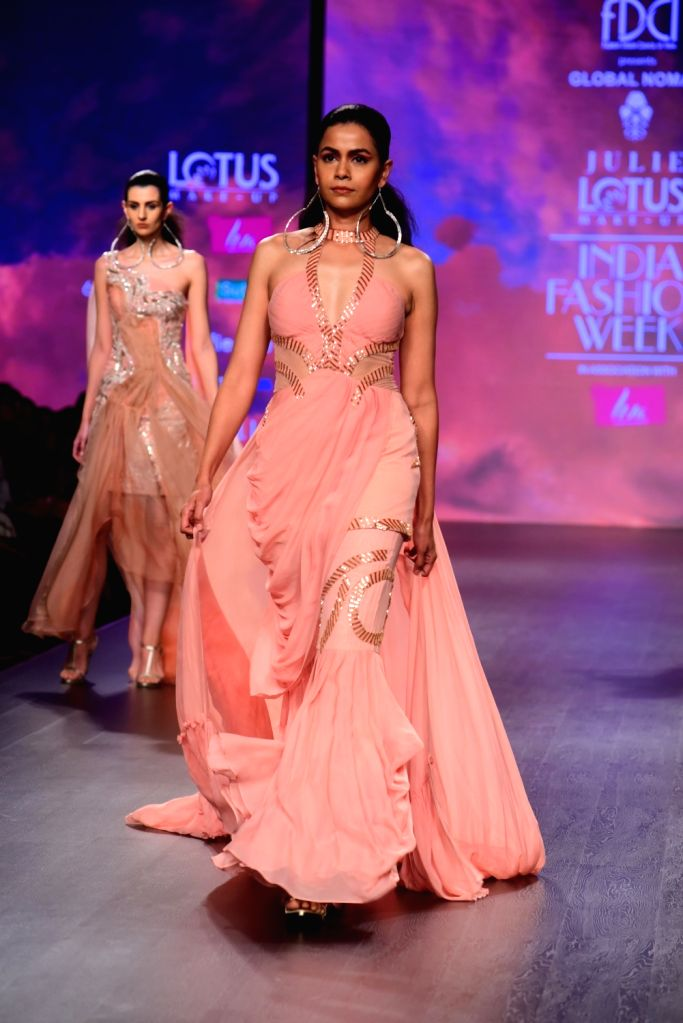 Models showcase fashion designer Julie Shah's creations on the second day of Lotus India Fashion Week in New Delhi, on March 14, 2019. - Julie Shah