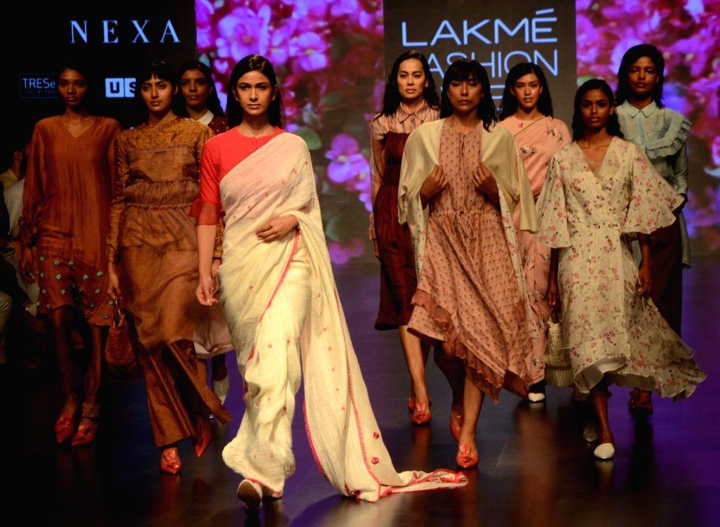 Models showcase fashion designer Kanika Jain's creation during Lakme Fashion Week (LFW) Summer/Resort 2019 in Mumbai, on Feb 2, 2019. - Kanika Jain