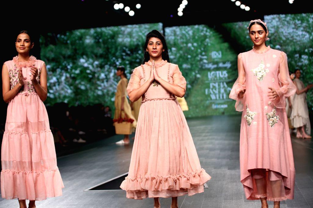 Models showcase fashion designer Nidhika Shekhar's creations on the third day of Lotus Make-up India Fashion Week, in New Delhi on Oct 11, 2019.