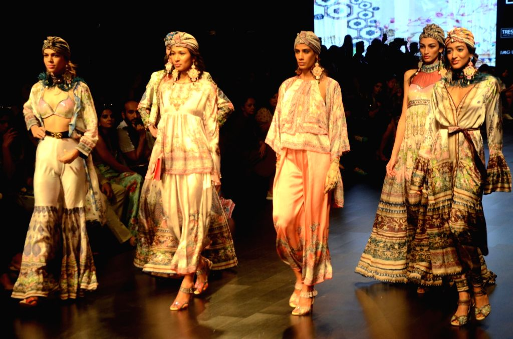 Models showcase fashion designer Rajdeep Ranawat's creation during Lakme Fashion Week (LFW) Summer/Resort 2019 in Mumbai, on Feb 1, 2019.