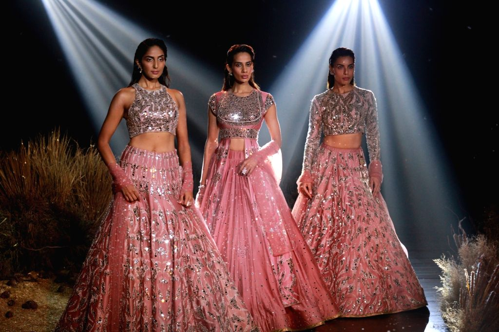 Models showcase fashion designer Reynu Tandon's creations at the India Couture Week 2019 in New Delhi, on July 26, 2019.