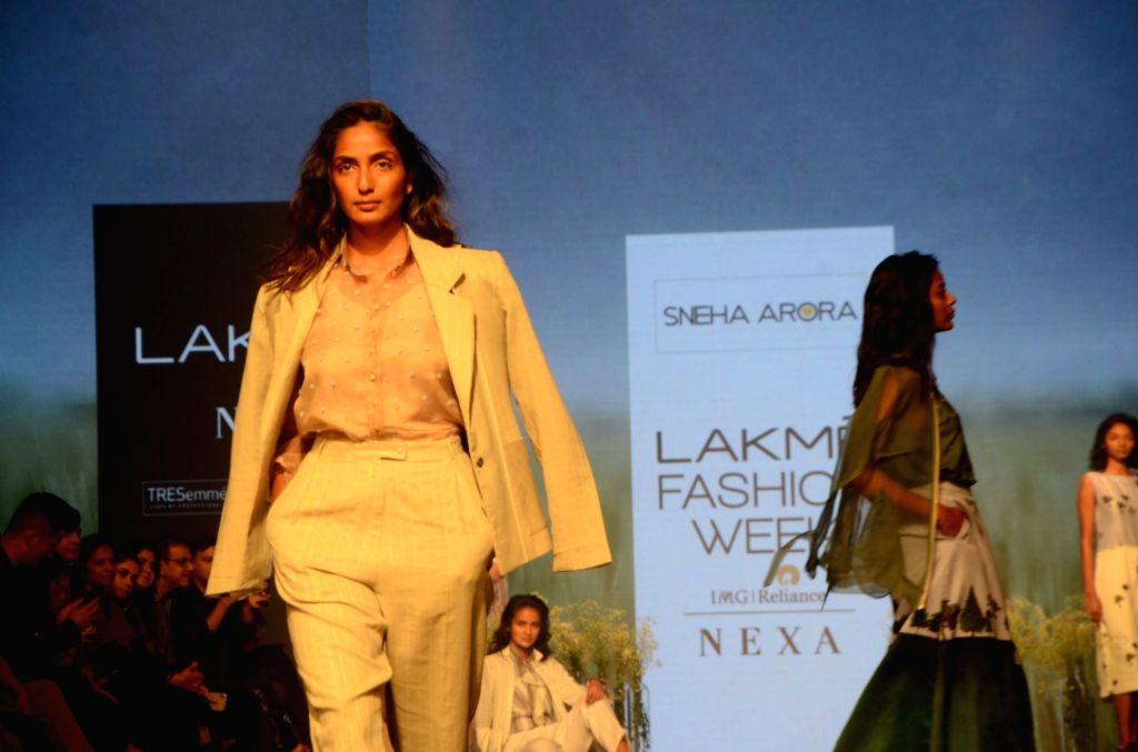 Models showcase fashion designer Sneha Arora's creation during Lakme Fashion Week (LFW) Summer/Resort 2019 in Mumbai, on Jan 30, 2019. - Sneha Arora