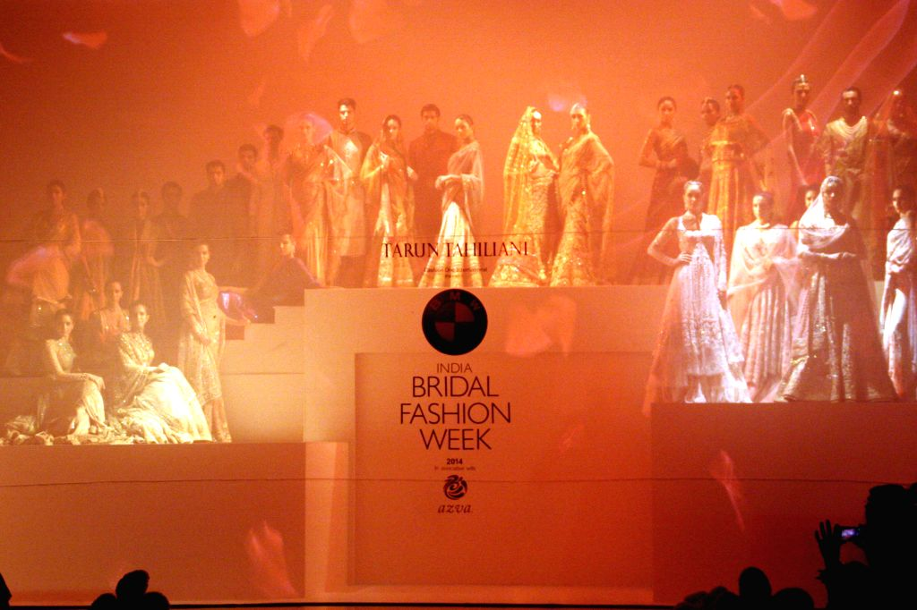 Models showcase fashion designer Tarun Tahiliani's creations during  `BMW India Bridal Fashion Week 2014` in New Delhi on Aug 7, 2014.