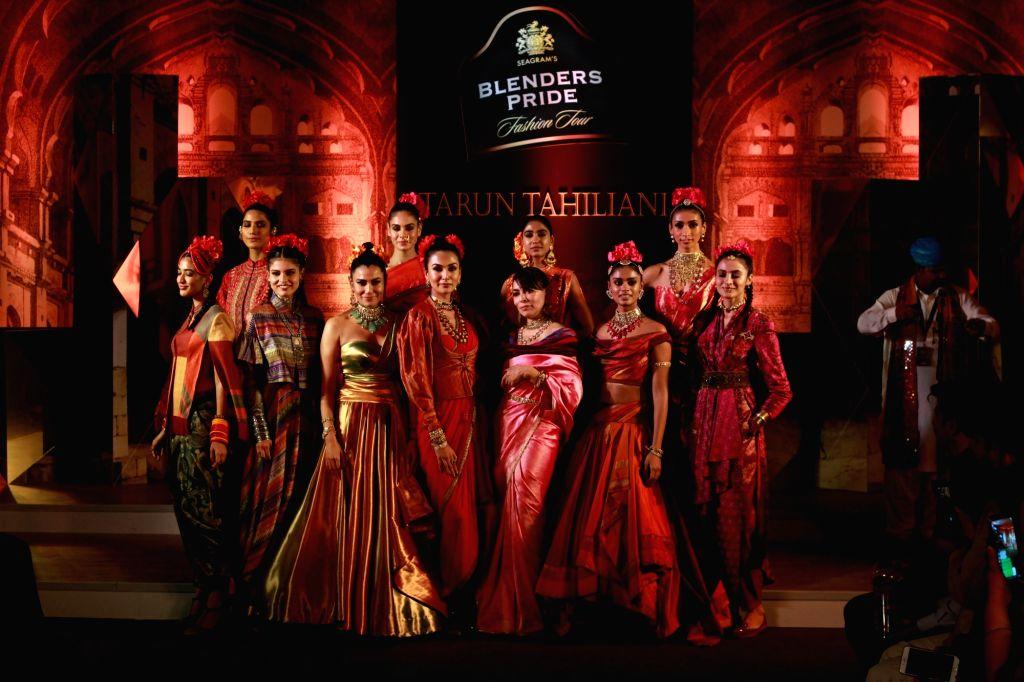 Models showcase fashion designer Tarun Tahiliani's creation at Blender's Pride Fashion Tour in Gurugram, on Dec 7, 2018.