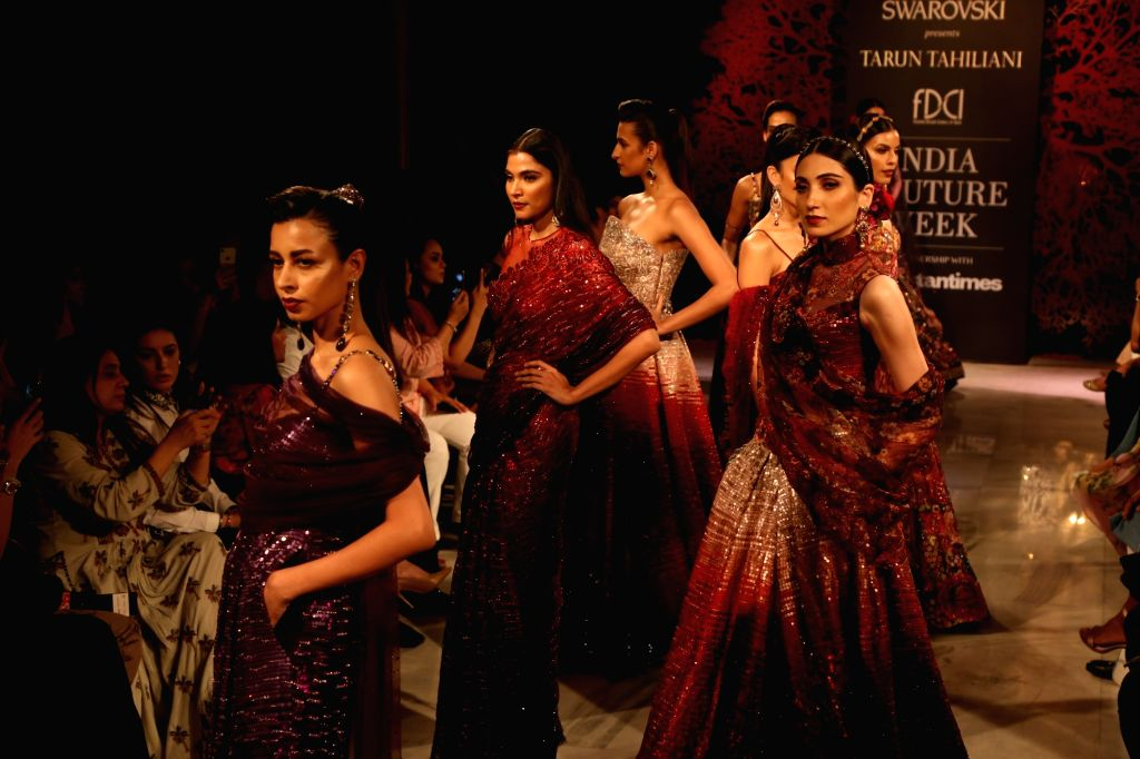 Models showcase fashion designer Tarun Tahiliani's creations at the India Couture Week 2019 in New Delhi, on July 28, 2019.