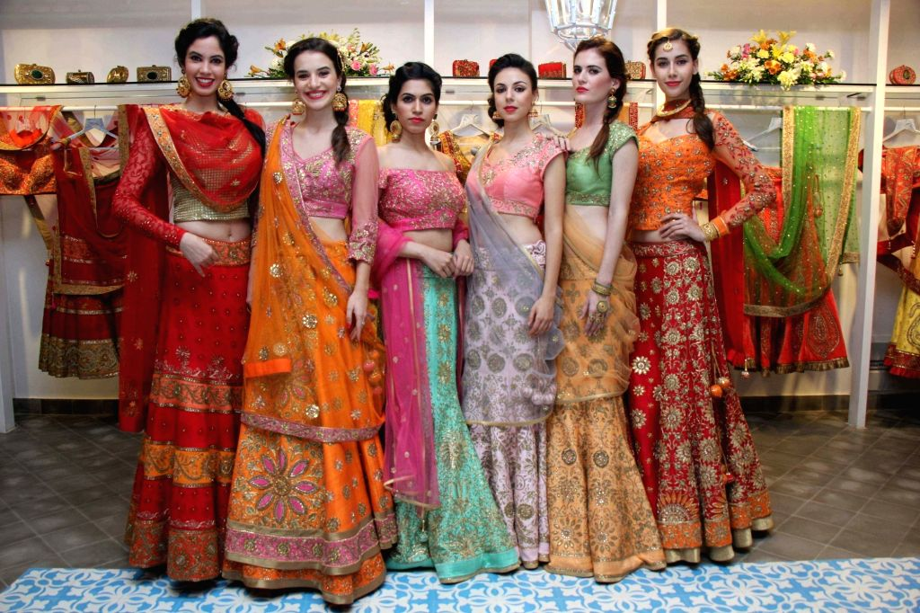Models showcase the Bridal/Fall Winter 2015 collection by designer Sumona Parekh in Mumbai on Oct 27, 2015.