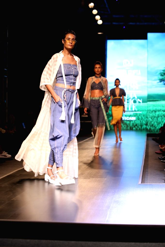 Models showcase the collection from fashion designer Amita Gupta's lineup 'Sustainable' on the first day of Lotus Make-up India Fashion Week, in New Delhi on Oct 9, 2019. - Amita Gupta