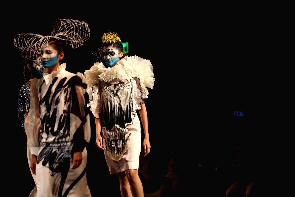 Models showcase the collection from fashion designer Nitin Bal Chauhan's fashion label 'Abstract' on the second day of Lotus Make-up India Fashion Week, in New Delhi on Oct 10, 2019. - Nitin Bal Chauhan