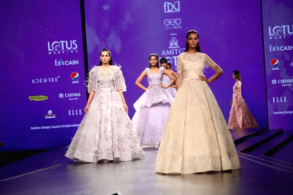 Models showcase the creation of fashion designer Amit GT on the third day of Lotus Make-up India Fashion Week, in New Delhi on Oct 11, 2019.