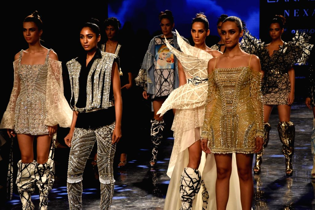 Models showcase the creation of fashion designer Swapnil Shinde on Day 2 of the Lakme Fashion Week Summer/Resort 2020, in Mumbai on Feb 12, 2020.