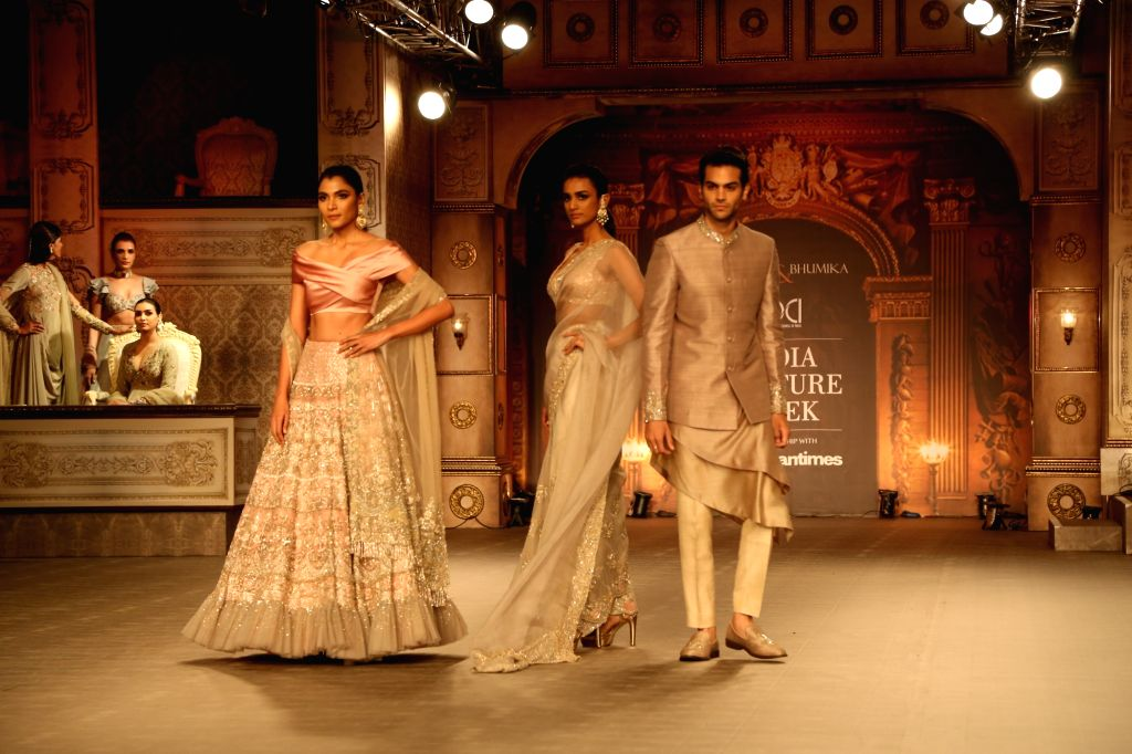 Models showcase the creations of fashion designers Shyamal and Bhumika at India Couture Week 2019 in New Delhi, on July 25, 2019.