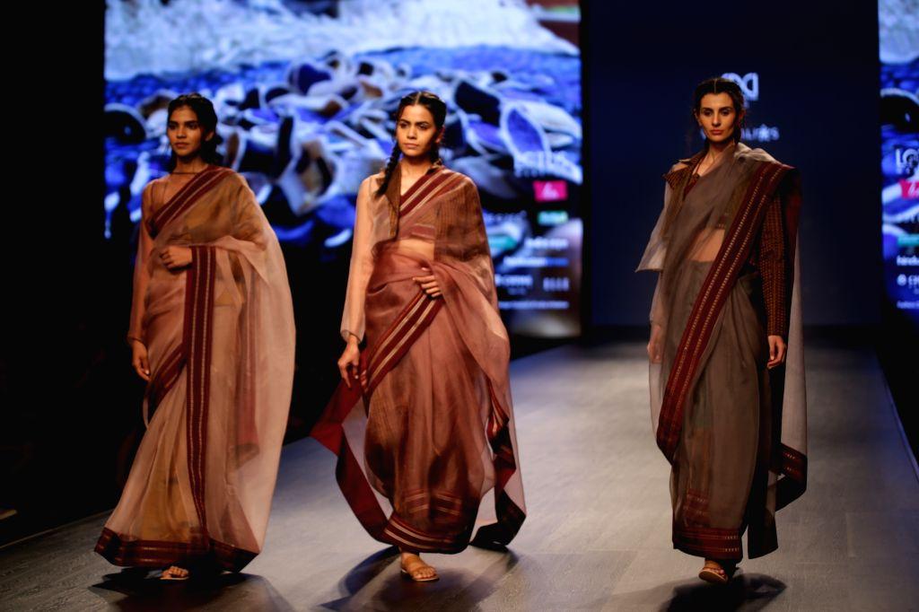 Models showcase the creations of fashion designer Vaishali Shadangule on Day 1 of Lotus India Fashion Week in New Delhi, on March 13, 2019.
