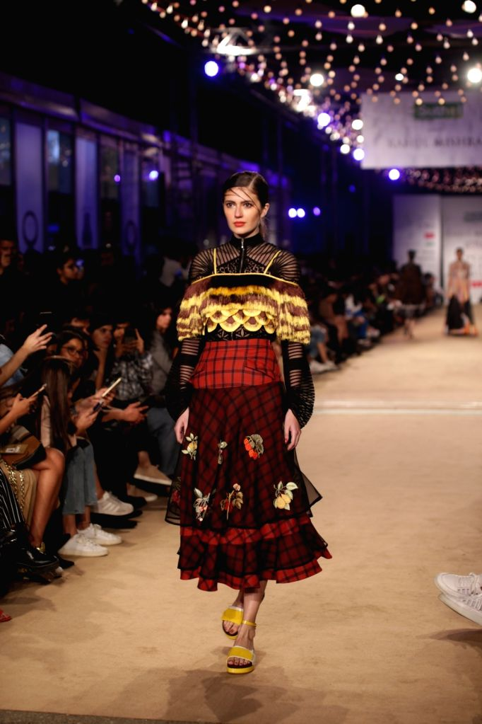 Models showcase the creations of fashion designer Rahul Mishra on the opening day of Lotus India Fashion Week in New Delhi, on March 13, 2019. - Rahul Mishra