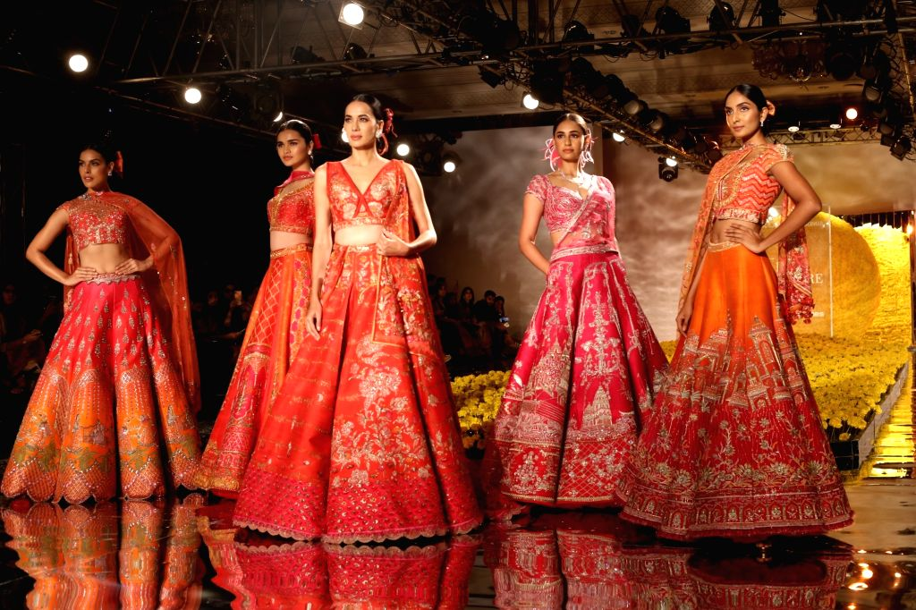 Models showcase the creations of fashion designer Sulakshana Monga at the India Couture Week 2019 in New Delhi, on July 25, 2019.