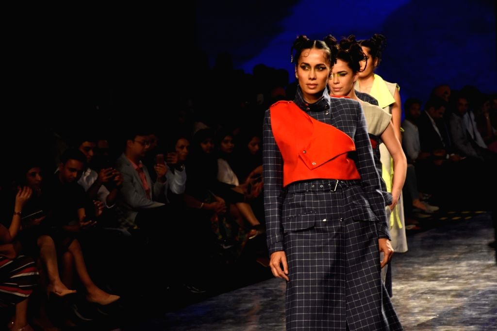 Models showcase the creations of fashion designer Itishree Satpathy on Day 2 of the Lakme Fashion Week Summer/Resort 2020, in Mumbai on Feb 12, 2020.