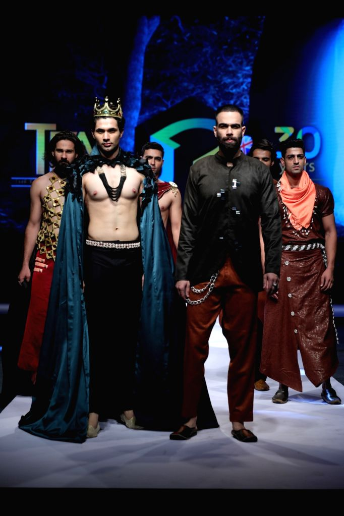 Models showcase the creations of students of JD Institute of Fashion Technology at a fashion event in New Delhi, on June 14, 2019.