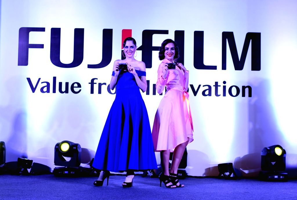 Models showcase the newly launched Fujifilm X-E3, the latest addition to the X Series range of premium mirrorless digital cameras in New Delhi on Oct. 11, 2017.