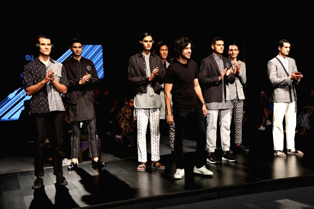 Models showcases the collection of menswear label Bareek on the fourth day of Lotus Make-up India Fashion Week, in New Delhi on Oct 12, 2019.