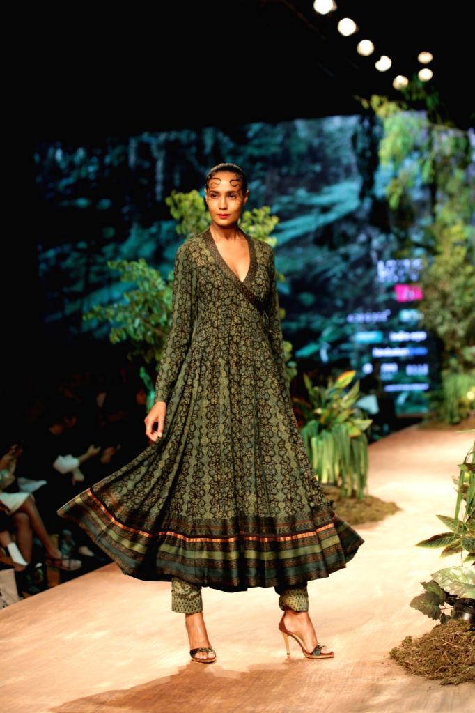 Models showcases the creation of fashion designer Shalini James on the opening day of Lotus India Fashion Week in New Delhi, on March 13, 2019.