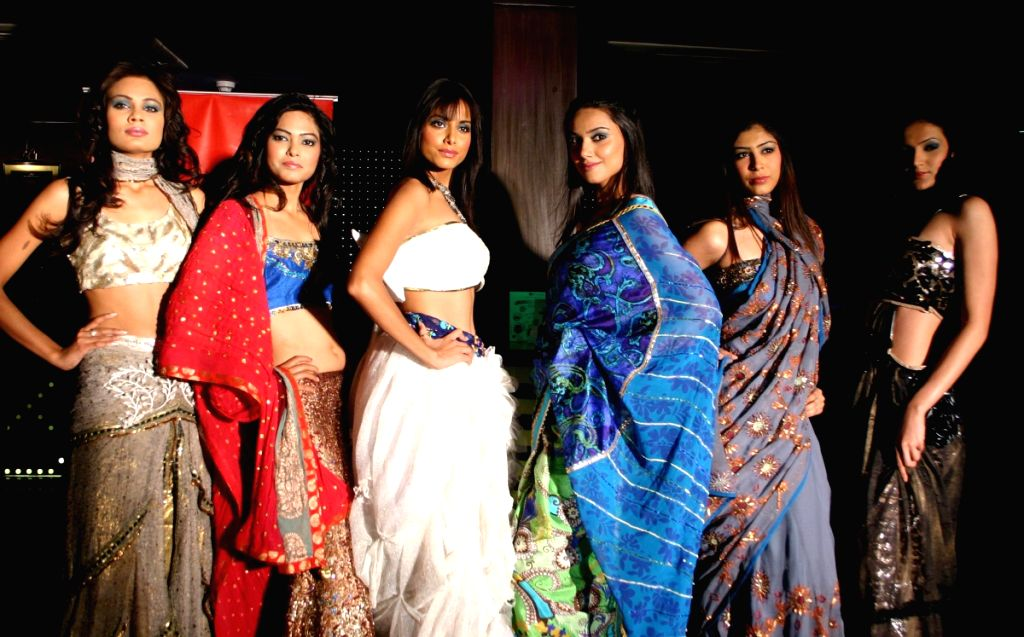 Models Showcasing Designer Preeti Ball's Spring Summer collection 2009 at F-Bar in New Delhi on Saturday.