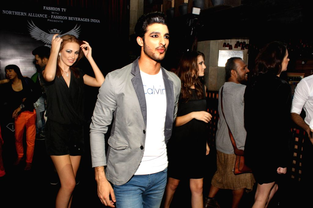 Models showcasing fashion brand Calvin Klein's latest collection alongwith launch of F-88 energy drink in New Delhi on September 05,2014.