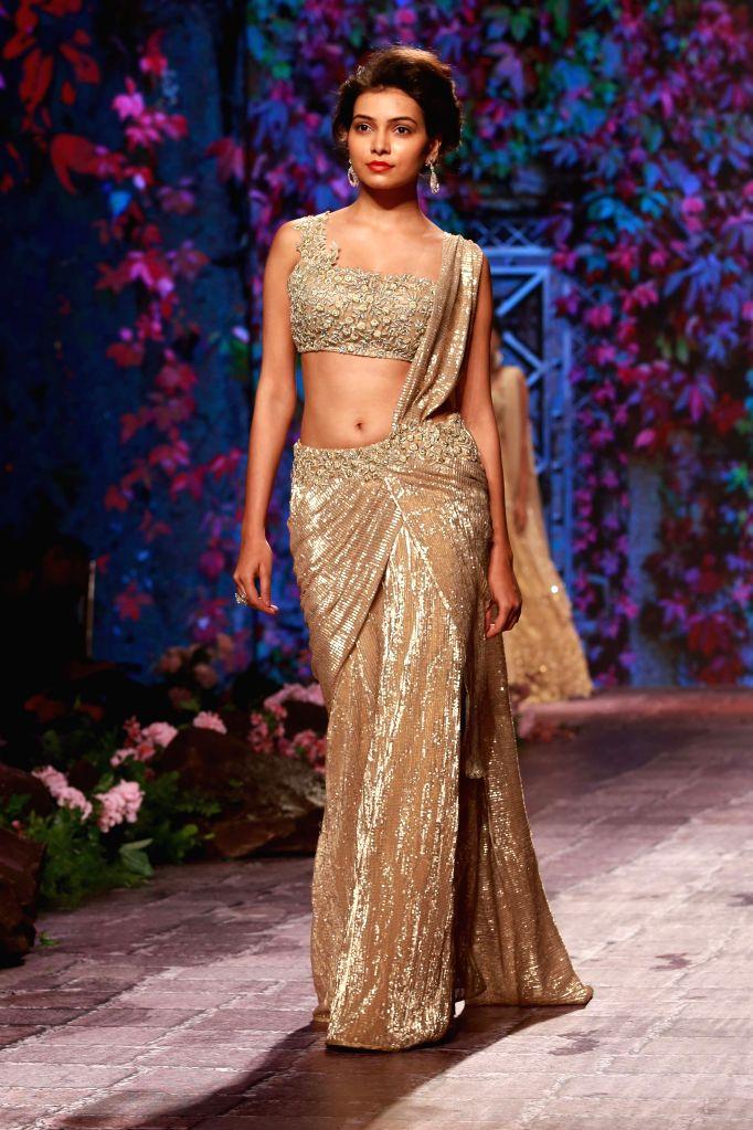 Models showcasing fashion designers Jyotsna Tiwari's creation walk the ramp during BMW India Bridal Fashion Week in New Delhi on Aug 9, 2015.