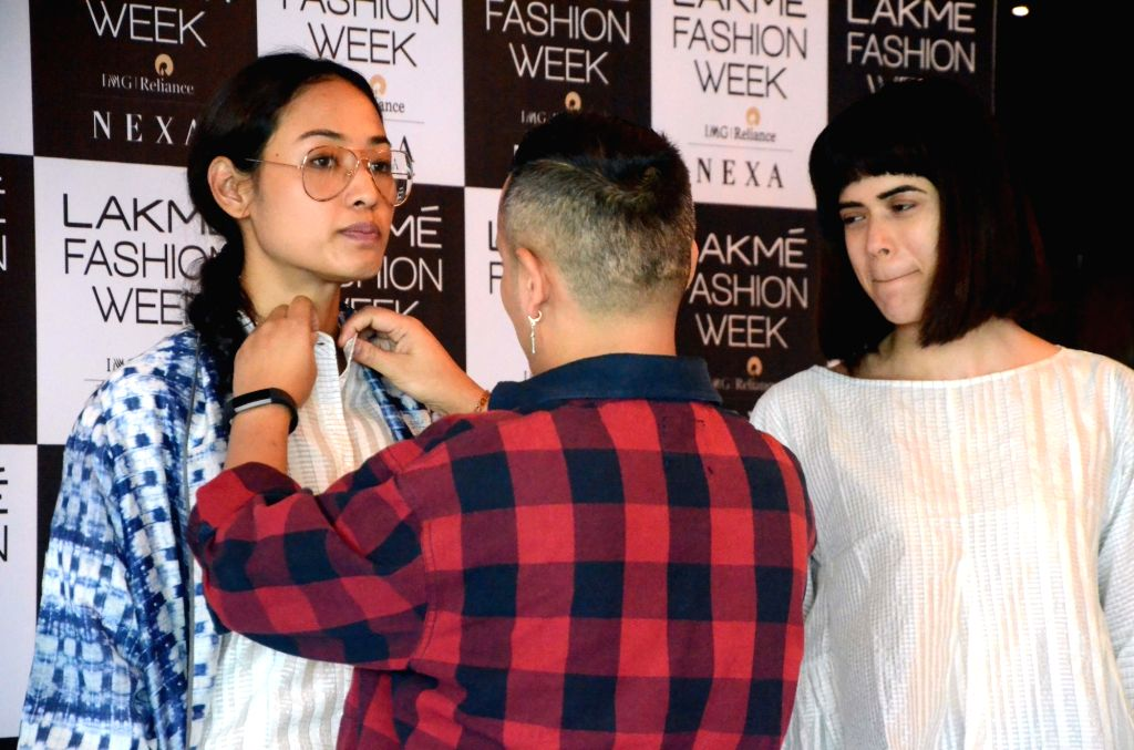 Models take part in fitting session for the upcoming Lakme Fashion Week Summer Resort 2018 in Mumbai on January 29, 2018.