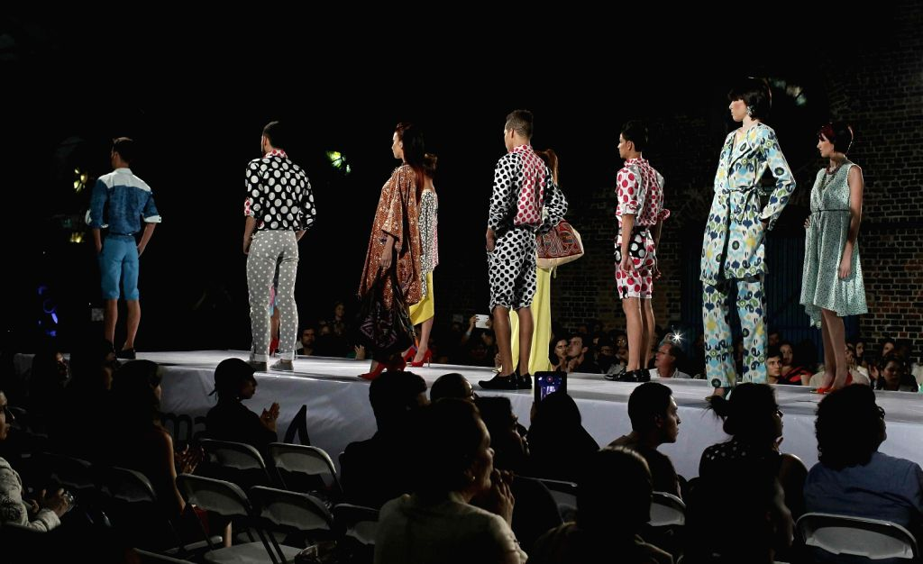 Models take the catwalk at the 11th edition of the Fashion Week in San Jose, Costa Rica, 09 August 2013. The event, which takes place until next 11 August, shows the most outstanding in fashion, ...