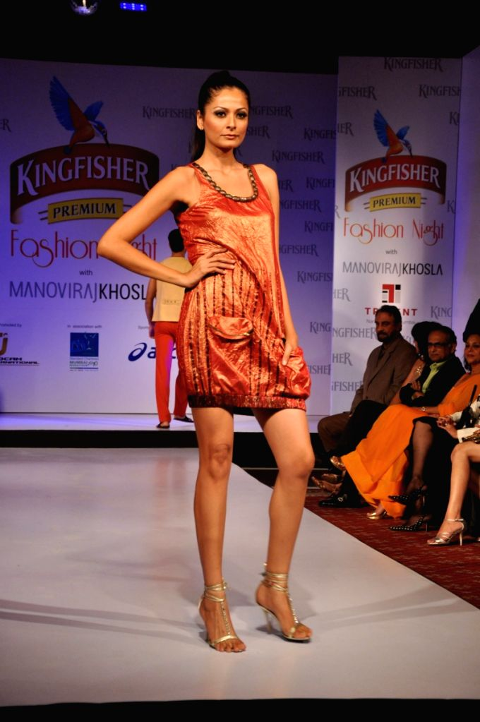 Models walk at SCMM Fashion Night at Hilton Towers in Mumbai.