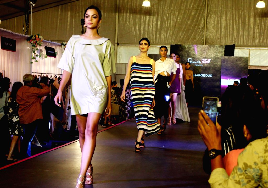 Models walk on the ramp at Pernia Pop Up Fashion Show 2018, in Mumbai on March 30, 2018.