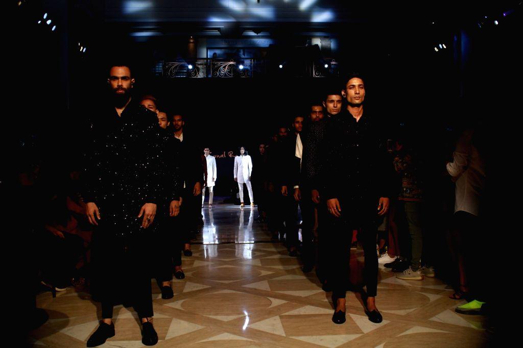 Models walk the ramp at the inauguration of fashion designer Kunal Rawal's store in New Delhi, on Sep 12,2019.