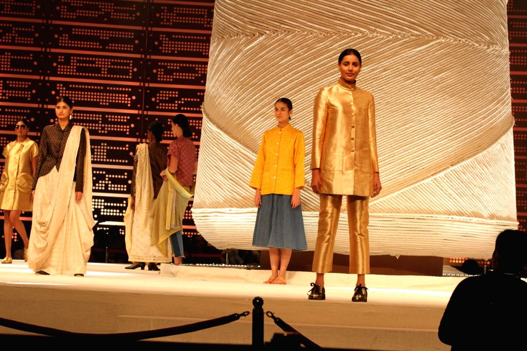 Models walk the ramp at the India Handloom Brand fashion show on second day of the Indian Textiles 2017 at Mahatma Mandir in Gandhinagar on July 2, 2017.