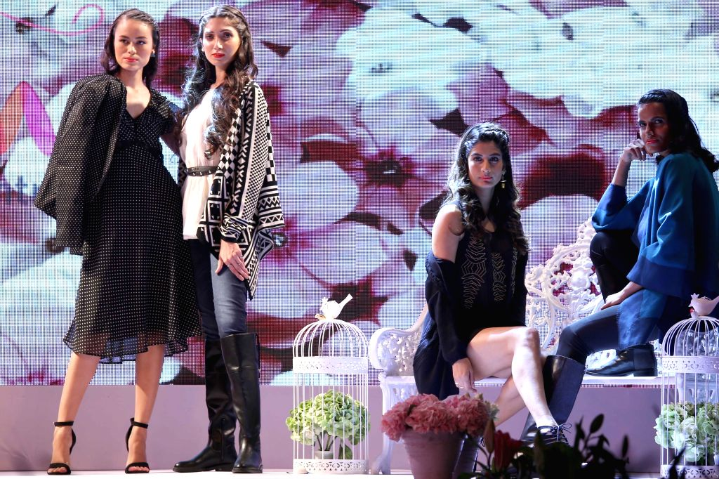 Models walk the ramp at the launch of an apparel brand in New Delhi, on Oct 20, 2015.